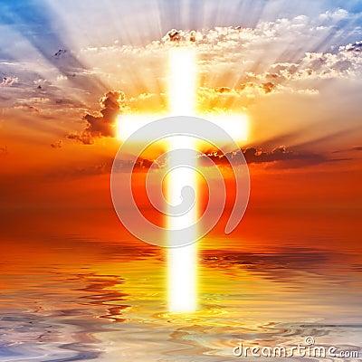 Cross on sunrise sky