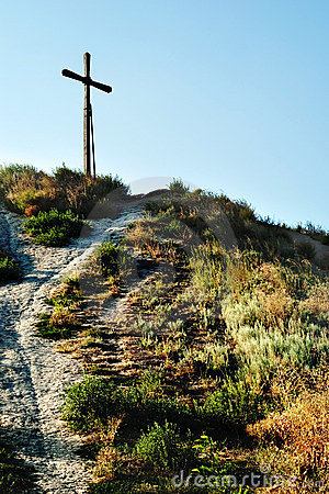 Cross on top of mountain