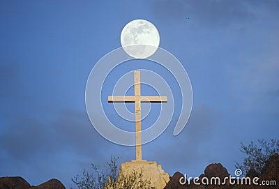 Cross under full moon