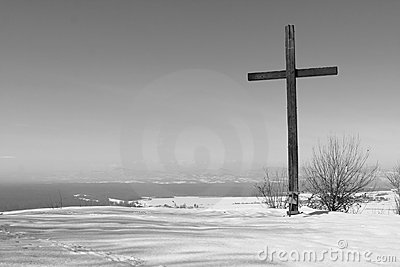 Cross in wintry landscape