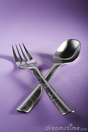 Crossed spoon and fork
