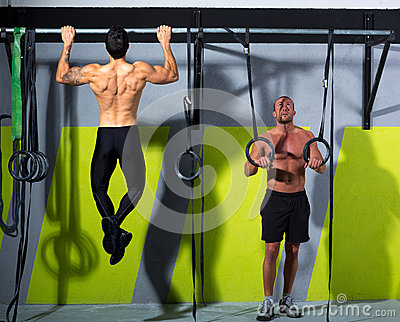 Crossfit dip ring and toes to bar man pull-ups men