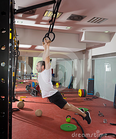 Crossfit fitness dip ring swing exercise man workout