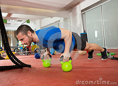 Crossfit fitness man push ups Kettlebells pushup exercise