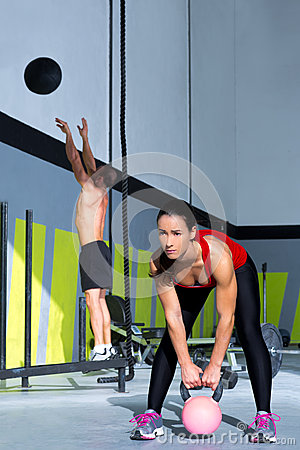 Free Crossfit Gym Kettlebell Woman And Wall Ball Man Stock Photo - 28359080