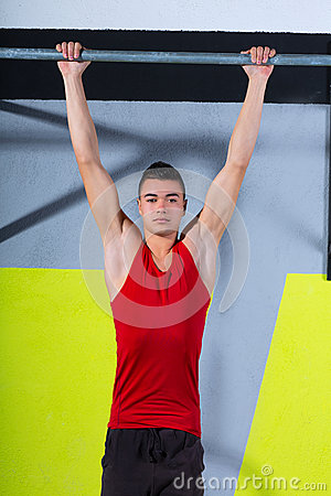 Crossfit toes to bar young man pull-ups 2 bars workout