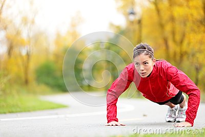 Crossfit woman doing push-ups