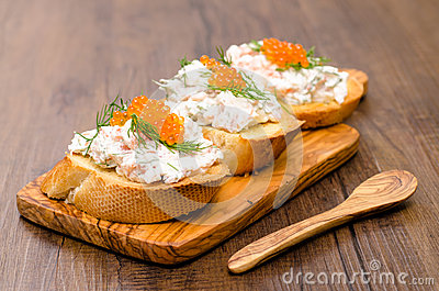 Crostini with smoked salmon and trout caviar