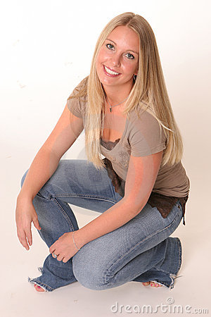 Free Crouching Blonde Teen Stock Photo - 761830