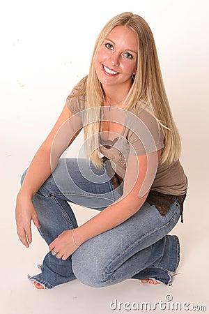 Crouching blonde teen