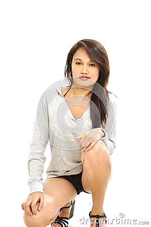 Crouching sexy Asian woman