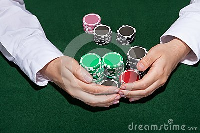 Croupier collecting in the bets