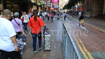 Busy city people crowd walking along the street stock footage