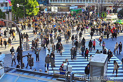 Crowd disperses at zebra crossing in busy street Editorial Image