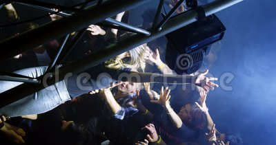 Crowd surfing at a concert 4k. Crowd surfing at a concert in nightclub 4k stock video