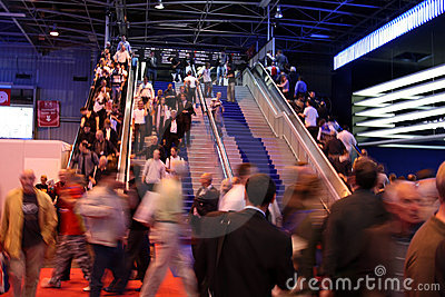 Crowd walking down stairs