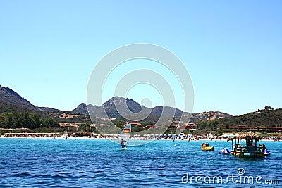 Crowded Beach In Golfo Di Marinella, Sardinia Editorial Photo