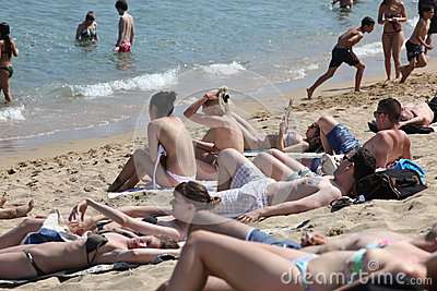 Crowded beach with tourists and locals in s Editorial Photo