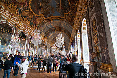 Crowds of tourists visit the Palace of Versailles Editorial Image