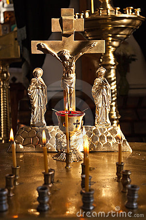 Crucifix and burning candles.