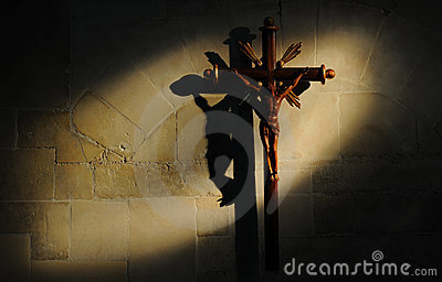 Crucifix on stone wall