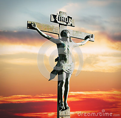 Crucifixion of Jesus Christ on the sunset