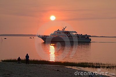 Cruise boat at sunset