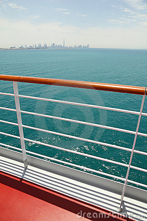 Cruise liner deck with red floor and wooden rail