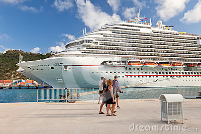 Cruise Passengers Walk Along Pier to Cruise Ship Editorial Photo