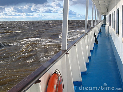 Cruise ship deck in the sea with strong waves