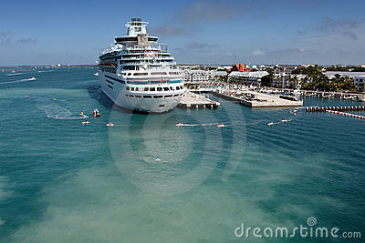 A cruise ship docked and anonymous people