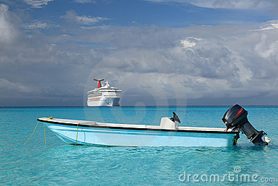 Cruise ship and fishing boat in blue ocean