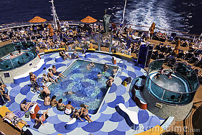 Cruise Ship Fun - Pool Hot Tub Sunbathing Editorial Photo