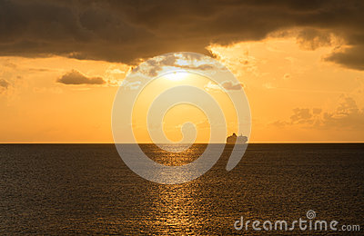 Cruise ship on horizon at sunset