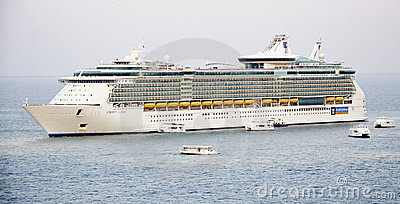 Cruise ship Liberty of the Seas and Tender Boats Editorial Image