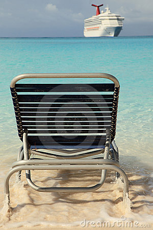 Cruise ship and lounge chair in blue ocean