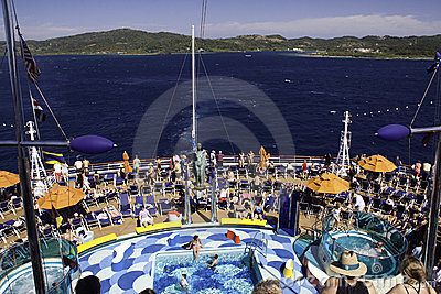 Cruise Ship  - Pool Deck and Island Views Editorial Stock Image