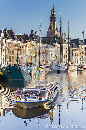 Cruiseboat on a tour through the canals of Groningen Editorial Photography