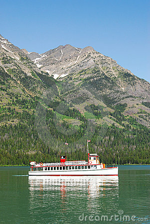 Cruising boat on waterton lake