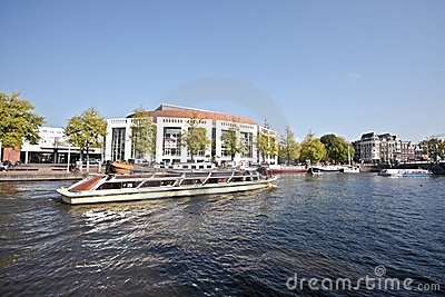 Cruising on the river Amstel Amsterdam Netherlands