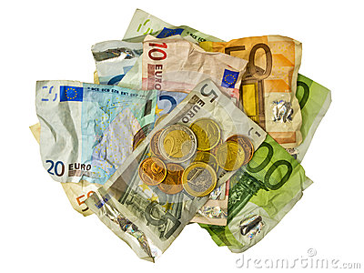 Crumpled Euro banknotes and coins