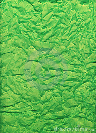 Crumpled and folded bright green tissue paper