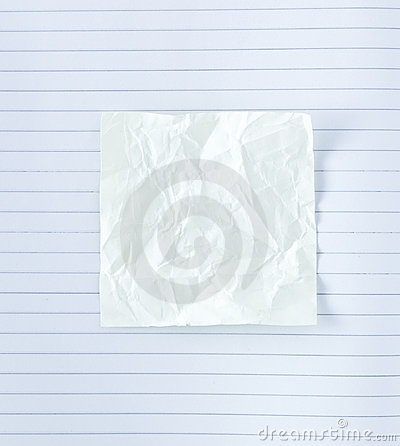 Crumpled notepad on paper lines