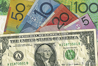 A crumpled US dollar bill over Australian money