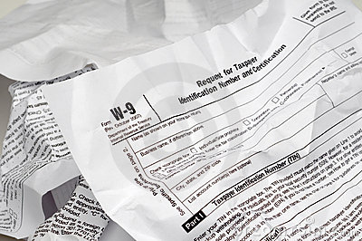 Crumpled W-9 income tax form