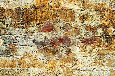 Crusted old brick wall