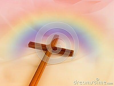 Cruz com arco-íris