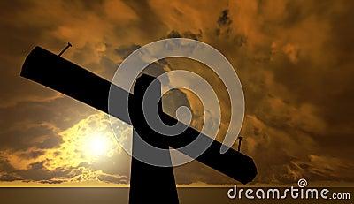 Cruz negra contra el cielo