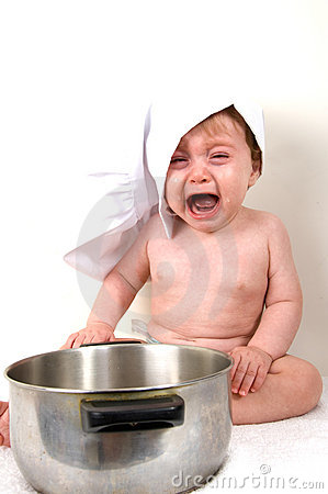 Crying baby with pan and cap