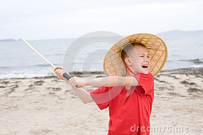 Crying Boy Plays With Samurai Sword Royalty Free Stock Image - Image: 25300786